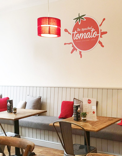 the-sqaushed-tomato-signage